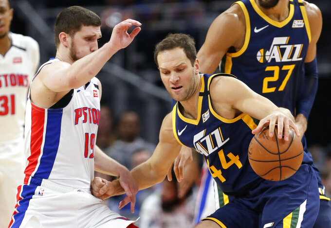 FILE - In this March 7, 2020, file photo, Utah Jazz forward Bojan Bogdanovic (44) drives against Detroit Pistons guard Sviatoslav Mykhailiuk (19) during the first half of an NBA basketball game in Detroit. The Utah Jazz announced that forward Bogdanovic underwent surgery Tuesday, May 19, 2020, to repair a ruptured ligament in his right wrist. (AP Photo/Duane Burleson, File)