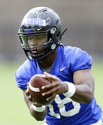 In this photo taken Friday, Aug. 2, 2019, Duke quarterback Quentin Harris (18) runs the ball during an NCAA college football practice in Durham, N.C. (AP Photo/Gerry Broome)