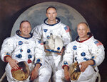 This March 30, 1969 photo made available by NASA shows the crew of the Apollo 11, from left, Neil Armstrong, commander; Michael Collins, module pilot; Edwin E.