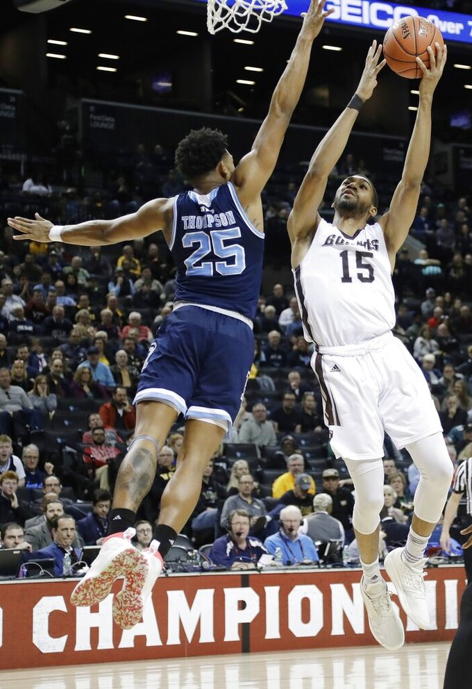 St. Bonaventure's LaDarien Griffin (15) drives past Rhode Island's Christion Thompson (25) during the first half of an NCAA college basketball game in semifinal round of the Atlantic 10 men's tournament Saturday, March 16, 2019, in New York. (AP Photo)