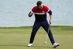 Team USA's Patrick Cantlay reacts to his putt on the third hole during a singles match the Ryder Cup at the Whistling Straits Golf Course Sunday, Sept. 26, 2021, in Sheboygan, Wis. (AP Photo/Charlie Neibergall)