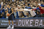 "FILE- In this Dec. 3, 2016, file photo, Maine's Ilija Stojiljkovic (11) looks to in-bound the ball as the Cameron Crazies shout from behind during an NCAA college basketball game against Duke in Durham, N.C. As the season begins in earnest this week, with a full slate of Division I games Wednesday, fans will notice the absence of traditions such as the Silent Night game across the college basketball landscape. The population of Krzyzewskiville at Duke will be zero, the Oakland Zoo at Pittsburgh a bit more tame. The Orange Crush at Illinois will be less intimidating and the ghost-like sound of ""Rock Chalk Jayhawk"" at Kansas will be merely the echoes from thousands of previous wins.   (AP Photo/Ben McKeown, File)"