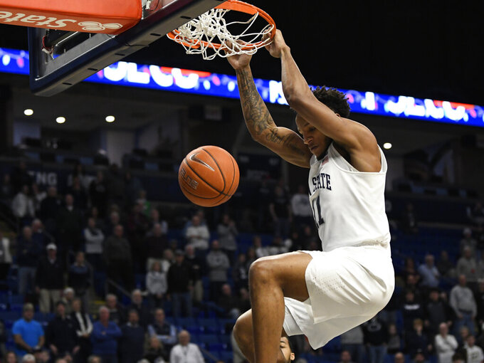 Penn State's Lamar Stevens (11) scores during the first half of an NCAA college basketball game against Central Connecticut State, Friday, Dec. 20, 2019, in State College, Pa. (AP Photo/John Beale)