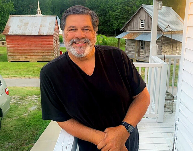 In this June 2020 photo provided by Deborah Shaw Laman, Clark Shaw poses for a photo in Tennessee. Clark Shaw, a Tennessee tourism leader who built Casey Jones Village into a popular tourist attraction in Jackson, Tenn., died Nov. 25 from complications from COVID-19. He was 66. (Deborah Shaw Laman via AP)