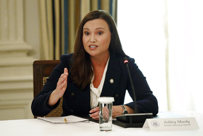FILE - In this June 8, 2020, file photo, Florida Attorney General Ashley Moody speaks during a roundtable discussion at the White House in Washington. On Wednesday, July 21, 2021, Moody tweeted that she has tested positive for COVID-19. Moody said she had been vaccinated for the virus earlier in the year. (AP Photo/Patrick Semansky, File)