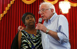 Democratic presidential candidate Sen. Bernie Sanders, right, I-Vt., shares the stage with Suynn Davis during a town hall meeting at the Victory Missionary Baptist Church in Las Vegas on Saturday, July 6, 2019. The air force veteran said she stopped taking her prescription drugs because she cannot afford them. (Steve Marcus/Las Vegas Sun via AP)
