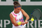 Italy's Sara Errani plays a shot against Netherlands' Kiki Bertens in the second round match of the French Open tennis tournament at the Roland Garros stadium in Paris, France, Wednesday, Sept. 30, 2020. (AP Photo/Michel Euler)