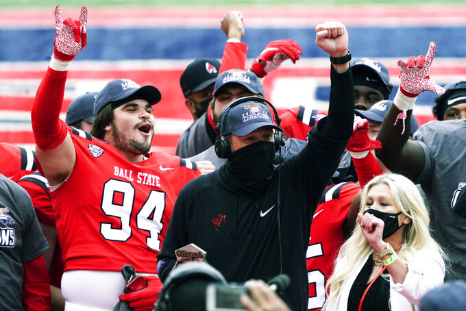 Ball State coach Mike Neu celebrates after Ball State defeated San Jose State 34-13 during the Arizona Bowl NCAA college football game Thursday, Dec. 31, 2020, in Tucson, Ariz. (AP Photo/Rick Scuteri)