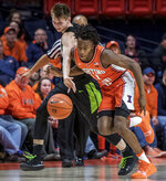 Illinois guard Ayo Dosunmu (11) chases a loose ball with Michigan State guard Matt McQuaid (20) during the first half of an NCAA college basketball game in Champaign, Ill., Tuesday, Feb. 5, 2019. (AP Photo/Rick Danzl)