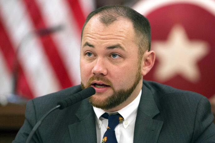 FILE- In this Nov. 10, 2014 file photo, New York City Councilman Corey Johnson speaks at a hearing in New York. Calling it