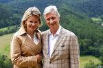 """FILE - In this Sunday, June 28, 2020 file photo, Belgium's King Philippe and Queen Mathilde pose for a photographer during a royal visit to the Giant's Tomb in Bouillon, Belgium. For the first time in Belgium's history, a reigning king has expressed regret for the violence carried out by the former colonial power when it ruled over what is now the Democratic Republic of the Congo. In a letter to the president of the DRC, Felix Tshisekedi, published Tuesday June 30, 2020 — the 60th anniversary of the African country's independence — Belgium's King Philippe conveyed his """"deepest regrets"""" for the """"acts of violence and cruelty"""" and the """"suffering and humiliation"""" inflicted on Belgian Congo. (Julien Warnand, Pool Photo via AP, File)"""