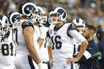 Los Angeles Rams quarterback Jared Goff (16) talks with s offensive tackle Andrew Whitworth (77) during a break during an NFL game against the Seattle Seahawks, Thursday, Oct. 3, 2019, in Seattle. The Seahawks defeated the Rams 30-29. (Margaret Bowles via AP)