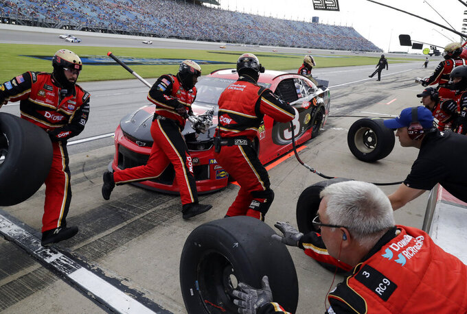 Austin Dillon makes a pit stop during a NASCAR Cup Series auto race at Chicagoland Speedway in Joliet, Ill., Sunday, June 30, 2019. (AP Photo/Nam Y. Huh)