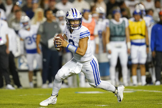 BYU quarterback Jaren Hall rolls out during the first half of the team's NCAA college football game against Arizona State on Saturday, Sept. 18, 2021, in Provo, Utah. (AP Photo/Rick Bowmer)