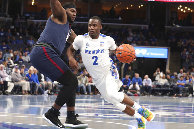 Memphis' Alex Lomax (2) works his way around South Carolina State's Elafayette Stone (55) during the second half of an NCAA college basketball game Tuesday, Nov. 5, 2019, in Memphis, Tenn. (AP Photo/Karen Pulfer Focht)