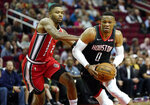 Houston Rockets' Russell Westbrook (0) drives toward the basket as Portland Trail Blazers' Kent Bazemore defends during the first half of an NBA basketball game Monday, Nov. 18, 2019, in Houston. (AP Photo/David J. Phillip)