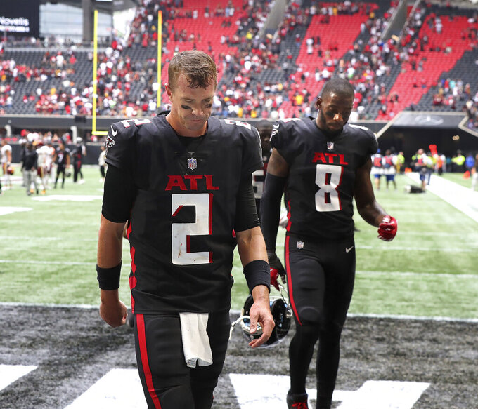 Atlanta Falcons quarterback Matt Ryan (2) and tight end Kyle Pitts (8) walk off the field after losing to the Washington Football Team in an NFL football game on Sunday, Oct. 3, 2021, in Atlanta. (Curtis Compton/Atlanta Journal-Constitution via AP)