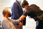 Chief of Police Carmen Best, right, gives an elbow-bump to activist and community organizer Andre Taylor, left, before a news conference Monday, June 22, 2020, in Seattle. (Ken Lambert/The Seattle Times via AP)