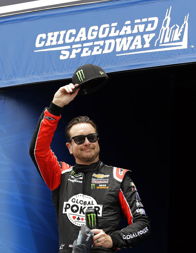 Kurt Busch waves to the crowd during drivers introduction before the NASCAR Cup Series auto race at Chicagoland Speedway in Joliet, Ill., Sunday, June 30, 2019. (AP Photo/Nam Y. Huh)