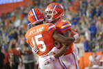 Florida wide receiver Jacob Copeland (15) is congratulated by wide receiver Trevon Grimes (8) after catching a pass for a 33-yard touchdown during the first half of an NCAA college football game against Arkansas, Saturday, Nov. 14, 2020, in Gainesville, Fla. (AP Photo/Phelan M. Ebenhack)