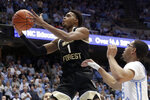 FILE - In this March 3, 2020, file photo, Wake Forest's Isaiah Mucius (1) drives against North Carolina's Garrison Brooks during the second half of an NCAA college basketball game in Chapel Hill, N.C. Mucius is the Demon Deacons' top returning scorer at 7.3 points per game entering this season. (AP Photo/Chris Seward, File)