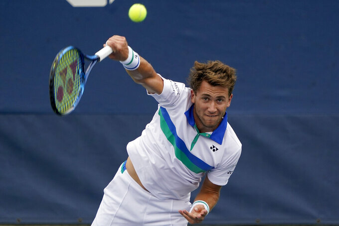 Casper Ruud, of Norway, serves to Botic Van De Zandschulp, of the Netherlands, during the second round of the US Open tennis championships, Wednesday, Sept. 1, 2021, in New York. (AP Photo/Elise Amendola)