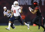 Fresno State quarterback Jorge Reyna (11) runs with the ball while defended by San Diego State safety Tariq Thompson during the first half of the NCAA college football game Friday, Nov. 15, 2019, in San Diego. (AP Photo/Orlando Ramirez)