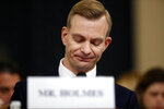 David Holmes, a U.S. diplomat in Ukraine, pauses as he testifies before the House Intelligence Committee on Capitol Hill in Washington, Thursday, Nov. 21, 2019, during a public impeachment hearing of President Donald Trump's efforts to tie U.S. aid for Ukraine to investigations of his political opponents.. (AP Photo/Andrew Harnik)