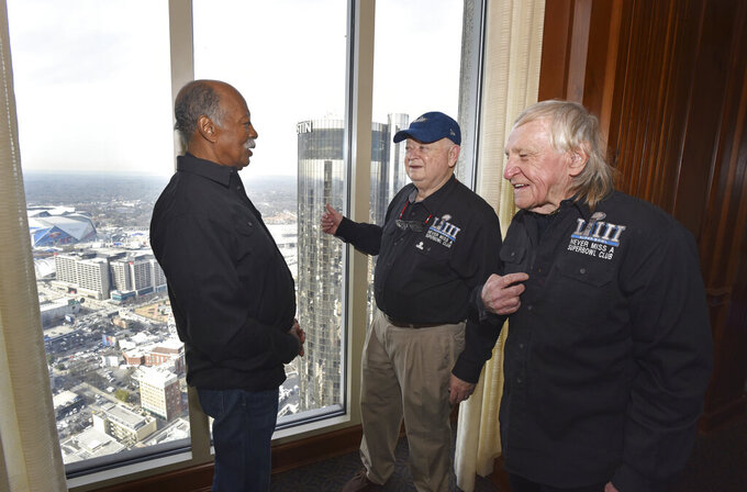 Members of the Never Miss a Super Bowl Club, from left, Gregory Eaton, Don Crisman and Tom Henschel, meet during a welcome luncheon in Atlanta on Friday, Feb. 1, 2019. (Hyosub Shin/Atlanta Journal-Constitution via AP)