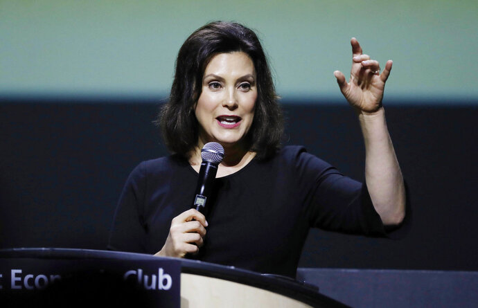 FIL E- In this Oct. 31, 2018 file photo, Michigan Democratic gubernatorial candidate Gretchen Whitmer speaks the Detroit Economic Club in Detroit. With new Democrats set to take over the governor's mansion across the country, the charter school movement may face a shifting political landscape in a number of key states. The incoming governors in California, Michigan, Illinois and New Mexico have all said they want to take the rare step of putting a temporary halt on new charter schools. (AP Photo/Carlos Osorio, File)