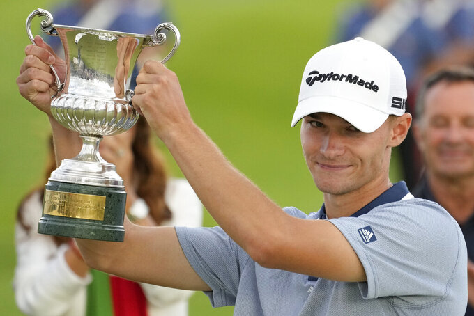 Nicolai Hojgaard of Denmark hold the trophy of the Italian Open golf tournament he just won, in Guidonia, in the outskirts of Rome, Sunday, Sept. 5, 2021. The Italian Open took place on the redesigned Marco Simone course just outside Rome that will host the 2023 Ryder Cup.(AP Photo/Andrew Medichini)