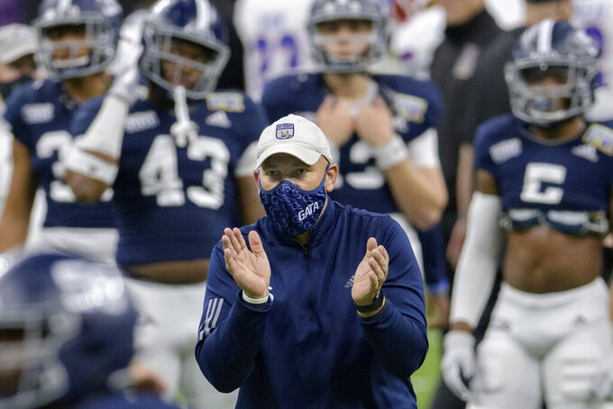 Georgia Southern head coach Chad Lunsford claps for his team during the New Orleans Bowl NCAA college football game against Louisiana Tech in New Orleans, Wednesday, Dec. 23, 2020. (AP Photo/Matthew Hinton)