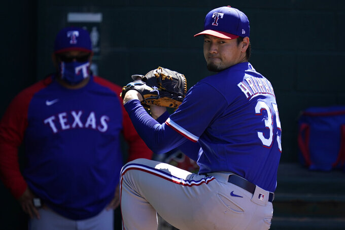 Texas Rangers starting pitcher Kohei Arihara (35) warms up before a spring training baseball game against the Chicago Cubs Monday, March 8, 2021, in Mesa, Ariz. (AP Photo/Ashley Landis)
