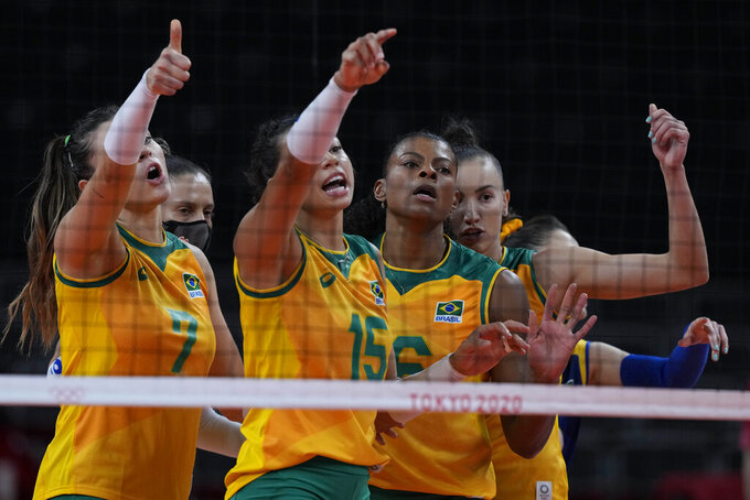Brazil players gesture during the women's volleyball semifinal match between Brazil and South Korea at the 2020 Summer Olympics, Friday, Aug. 6, 2021, in Tokyo, Japan. (AP Photo/Frank Augstein)