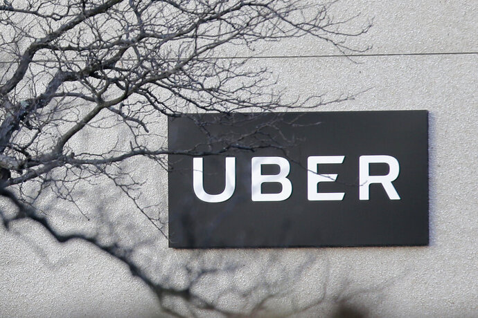 FILE - In this Nov. 15, 2019, file photo an Uber office is seen in Secaucus, N.J. Uber is offering riders a four-digit pin code to help ensure they're getting into the right car. The ride-hailing company is rolling out the new feature across the U.S. and Canada. (AP Photo/Seth Wenig, File)
