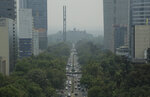 CORRECTS DATE - Smoke and pollution hangs over in Mexico City's iconic Reforma Avenue and Chapultepec Castle, Tuesday, May 14, 2019. Mexico City has declared a pollution emergency over smoke from brushfires that has cast a pall over the city of 9 million. The measure is not accompanied by the usual driving restrictions because this time the pollution isn't coming from cars. The city's pollution alerts are usually triggered by high ozone levels. (AP Photo/Gerardo Carrillo)