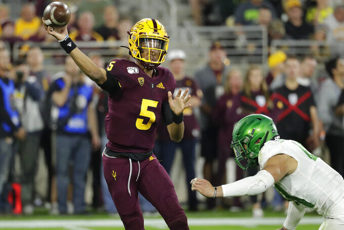 Arizona State quarterback Jayden Daniels (5) throws under pressure from Oregon linebacker Isaac Slade-Matautia during the second half of an NCAA college football game Saturday, Nov. 23, 2019, in Tempe, Ariz. Arizona State won 31-28. (AP Photo/Matt York)