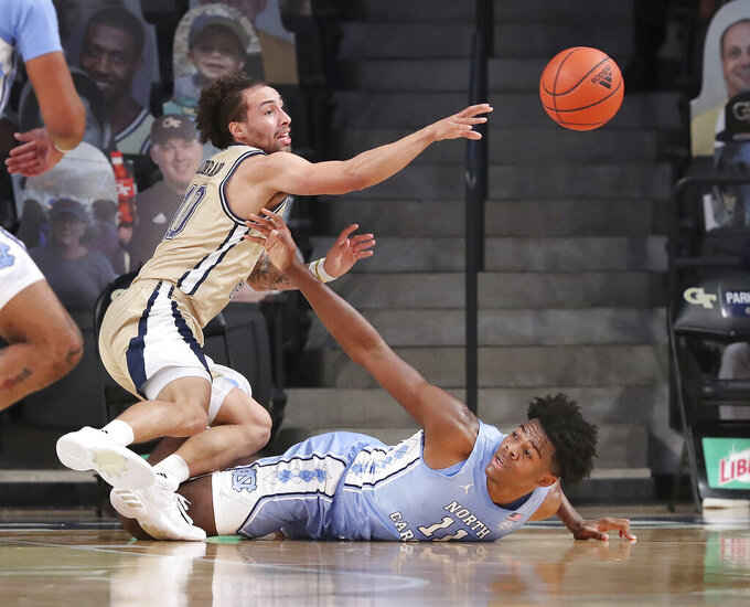 FILE - Georgia Tech guard Jose Alvarado steals the ball from North Carolina forward Day'Ron Sharpe during the first half of an NCAA college basketball game in Atlanta, in this Wednesday, Dec. 30, 2020, file photo. Alvarado ranks among the ACC leaders in several categories, including scoring, steals and assists, and his production is crucial to Georgia Tech's goal to make its first NCAA appearance since 2010. (Curtis Compton/Atlanta Journal-Constitution via AP, Pool, File)