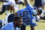 Tennessee Titans linebacker Derick Roberson (50) stretches during NFL football training camp Wednesday, July 28, 2021, in Nashville, Tenn. (AP Photo/Mark Zaleski)