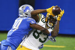 Green Bay Packers wide receiver Marquez Valdes-Scantling (83), defended by Detroit Lions cornerback Amani Oruwariye (24), falls into the end zone for a touchdown during the first half of an NFL football game, Sunday, Dec. 13, 2020, in Detroit. (AP Photo/Leon Halip)