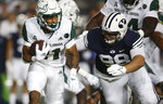 BYU defensive lineman Gabe Summers (98) tracks down South Florida running back Brian Battie (21) in the first half of an NCAA college football game Saturday, Sept. 25, 2021, in Provo, Utah. (AP Photo/George Frey)