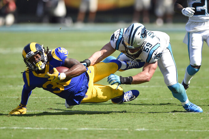 Carolina Panthers middle linebacker Luke Kuechly (59) tackles Los Angeles Rams running back Todd Gurley (30) during the second half of an NFL football game in Charlotte, N.C., Sunday, Sept. 8, 2019. (AP Photo/Mike McCarn)