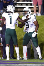 Michigan State running back Kenneth Walker III, right, celebrates with wide receiver Jayden Reed after scoring his second touchdown during the first half of an NCAA college football game against Northwestern in Evanston, Ill., Friday, Sept. 3, 2021. (AP Photo/Nam Y. Huh)