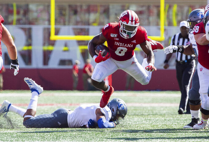 Indiana running back Stevie Scott III (8) is tripped up as he rushes the ball out of the backfield during the first half of an NCAA college football game against Easter Illinois, Saturday, Sept. 7, 2019, in Bloomington, Ind. (AP Photo/Doug McSchooler)