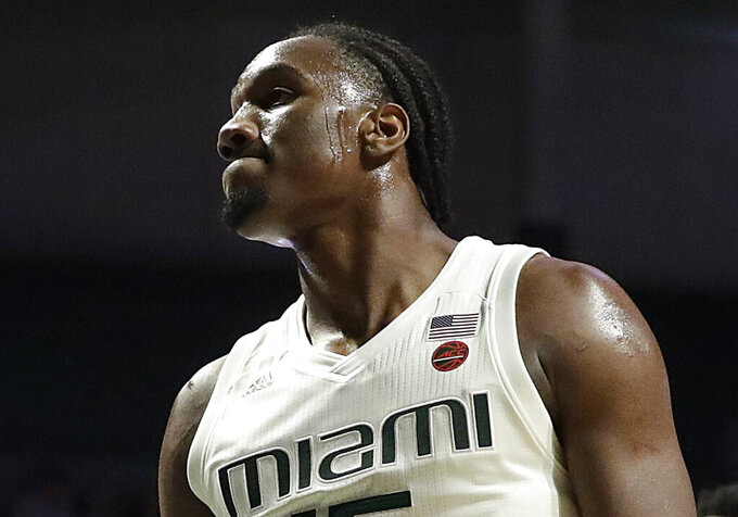 Miami Hurricanes center Ebuka Izundu reacts after a play during the first half of an NCAA college basketball game against North Carolina Tar Heels on Saturday, Jan. 19, 2019, in Coral Gables, Fla. (AP Photo/Brynn Anderson)