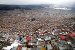 The capital city of La Paz is seen from El Alto, Bolivia, Friday, Oct. 18, 2019. President Evo Morales declared himself victor of the weekend election, stirring more anger among his opponents who have protested for days claiming fraud in the vote count, while the U.S., Brazil, Argentina and Colombia joined in calling for Bolivia to hold a runoff between the incumbent and his top challenger. (AP Photo/Jorge Saenz)