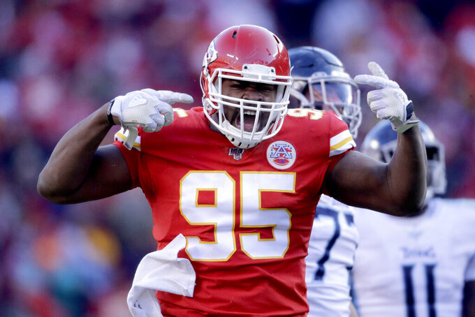 Kansas City Chiefs' Chris Jones reacts during the first half of the NFL AFC Championship football game against the Tennessee Titans Sunday, Jan. 19, 2020, in Kansas City, MO. (AP Photo/Charlie Riedel)