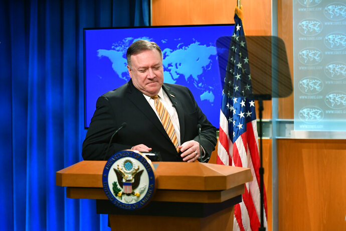 Secretary of State Mike Pompeo arrives for a press conference at the State Department, Wednesday, June 24, 2020 in Washington. (Mandel Ngan/Pool via AP)