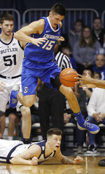 Creighton's Martin Krampelj (15) jumps over Butler's Sean McDermott, bottom, for a loose ball during the first half of an NCAA college basketball game, Saturday, Jan. 5, 2019, in Indianapolis. (AP Photo/Darron Cummings)