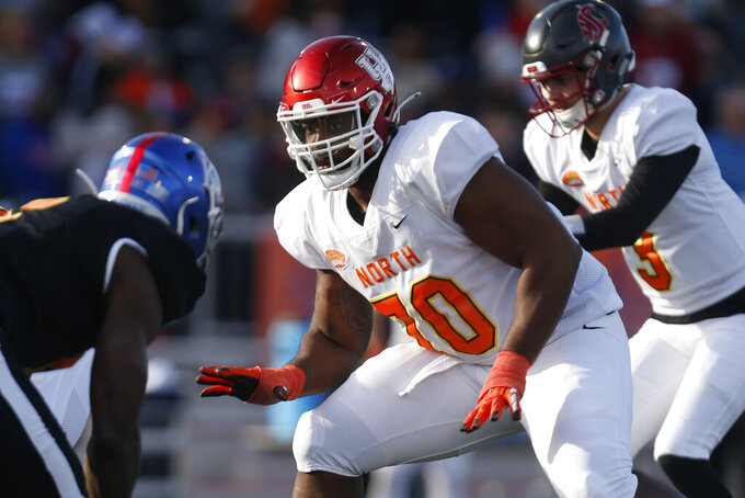 FILE - In this Jan. 25, 2020, file photo, North offensive tackle Josh Jones of Houston (70) is shown playing during the second half of the Senior Bowl college football game in Mobile, Ala. Josh Jones is a possible pick in the NFL Draft which runs Thursday, April 23, 2020, thru Saturday, April 25.(AP Photo/Butch Dill)